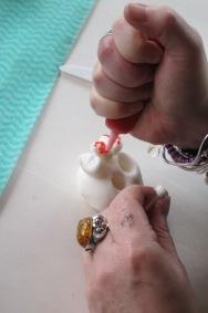 GOMA DAY OF THE DEAD SHRINE workshop , marie makes her sugar skulls.